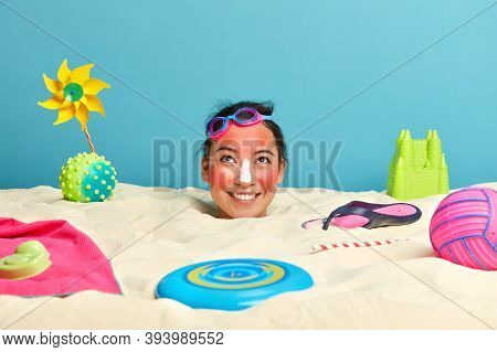 Glad Positive Young Asian Woman With Sunburned Skin, Applies Sunscreen On Nose For Skin Protection,