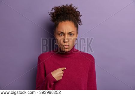 Image Of Disappointed Angry Woman Indicates At Herself, Irritated Being Selected, Smirks Face, Has C