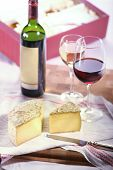 tomme de savoie, a semi firm french cheese and two glasses of wine ** note: slight blurriness, best at smaller sizes poster