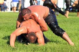 Wrestlers in a tight grip.