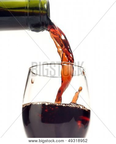 Red wine being poured into a glass of wine