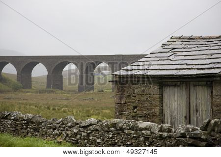 Old shed and viaduct Yorkshire Dales Yorkshire England