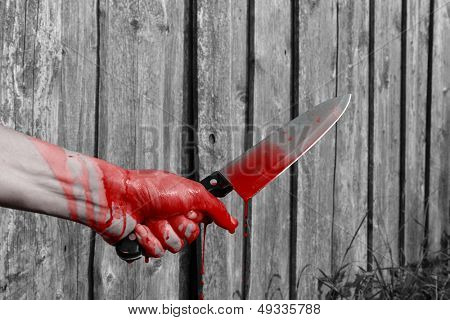 bloody hand with knife