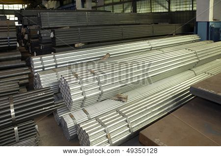 stack of steel pipes poster