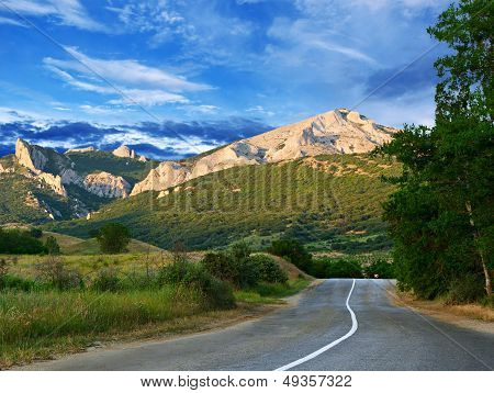 Road, Mountains And Blue Sky