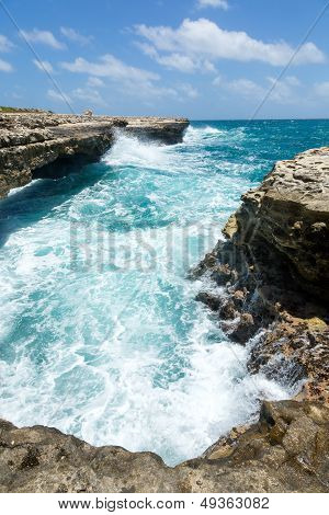 Waves Crashing On The Coastline Devil's Bridge Antigua