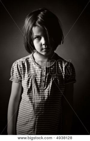 Low Key Black And White Shot Of A Sad Child