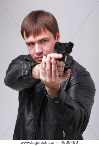 Aiming. Serious Man With A Gun.