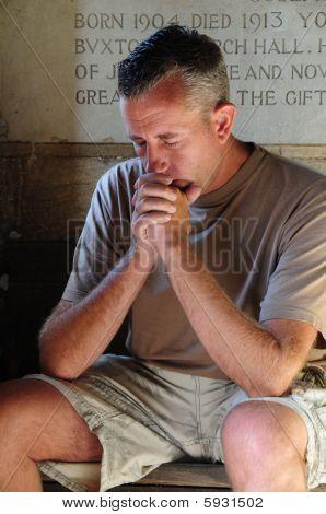 worried man praying