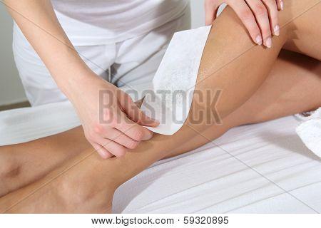 Woman Legs Waxed In Spa