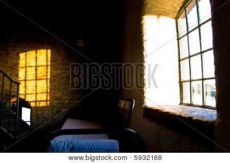 Sunset through window.