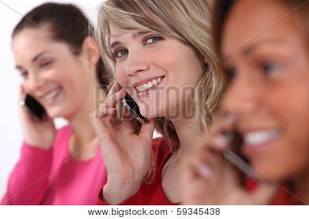 Young women talking on their mobile phones