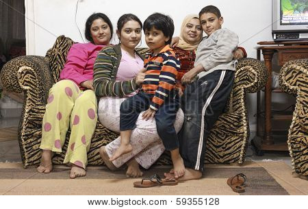 DAHAB, EGYPT - FEBRUARY 2, 2011: Egyptian family during riots in Cairo. Millions of protesters demanded the overthrow of the regime of Egyptian President Hosni Mubarak.