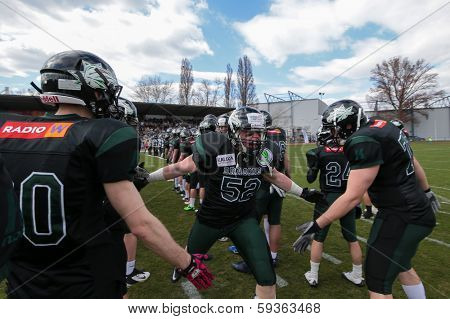 VIENNA,  AUSTRIA - APRIL 14 OL Boris Lisiecka (#52 Dragons) is welcomed by his team before the AFL football game on April 14, 2013 in Vienna, Austria.