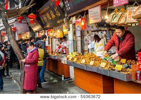 CHONGQING, CHINA - JAN 17: Unidentified merchants are selling traditional food on January  17, 2014 at Ciqikou Ancient Town, Chongqing, China.