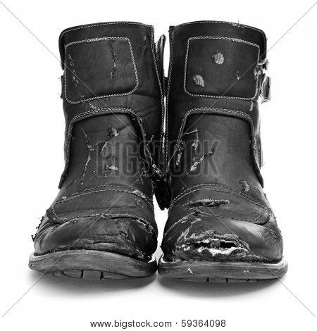 a pair of worn and torn boots on a white background