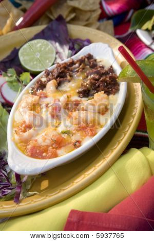 Mexican queso fundo with savory chorizo melted cheese and fresh shrimp. poster