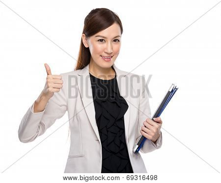 Asian businesswoman hold clipboard and laptop thump up