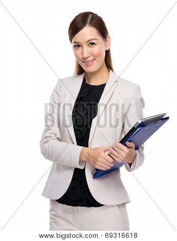 Businesswoman with clipboard and laptop