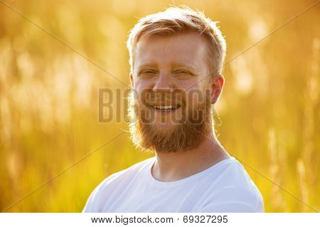 Cheerful Man With A Big Red Beard