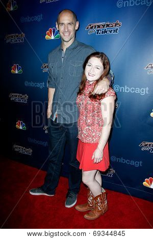 NEW YORK-JUL 30: Andy Cook and Abigail Baird of Aerial Animation attend the 'America's Got Talent' post show red carpet at Radio City Music Hall on July 30, 2014 in New York City.
