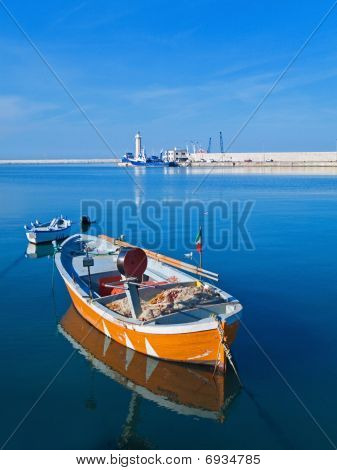 Landscape view of Molfetta touristic port with rowboats.