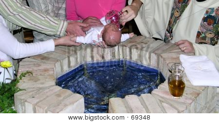 Baptism Of A Newborn Baby In A Catholic Church