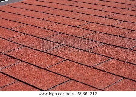 Red asphalt shingles