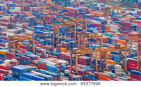 SINGAPORE - 2 JAN, 2014: Commercial port of Singapore. Thousands of steel containers waiting to be dispatch and shipped around the world from the biggest and busiest cargo port in Asia