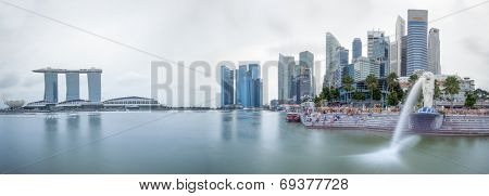 SINGAPORE - 1 JAN, 2014: Marina Bay central business district in Singapore. Day time city skyline panorama. Marina Bay Sands and Merlion statue are famous landmarks of the country