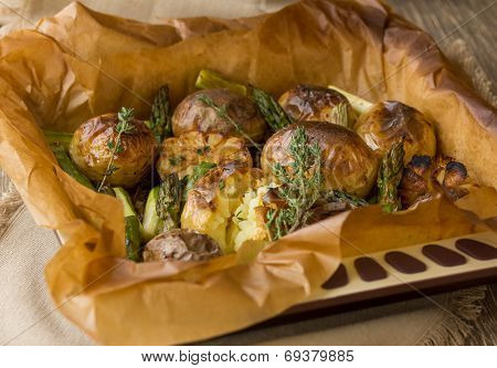 Potatoes baked wholly with green asparagus, garlic and thyme poster