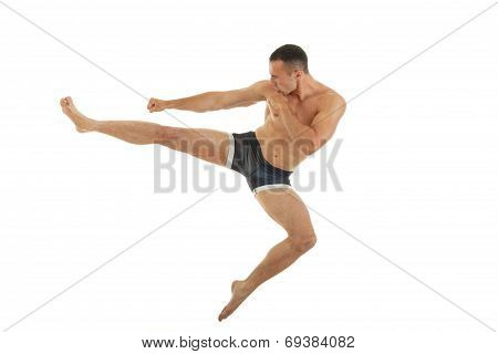 Excellent Fight Pose Of Intense Man Boxer With A Kick