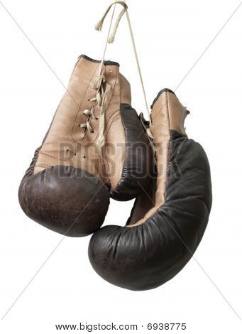 Old boxing gloves hanging on a lace