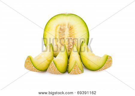 One half and four slices of a Galia Melon isolated on white Background poster