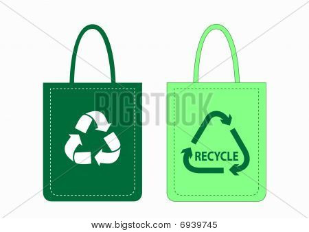 Green shopping bags with recycle symbols