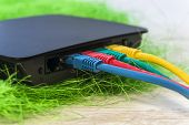 small network switch with various color RJ45 cables 5e connected for switching poster