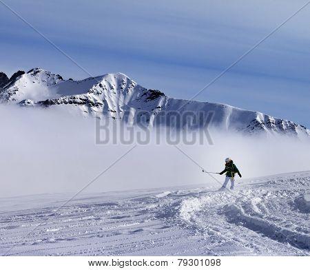 Snowboarder downhill on off-piste with newly fallen snow. Ski resort Gudauri. Caucasus Mountains Georgia. poster