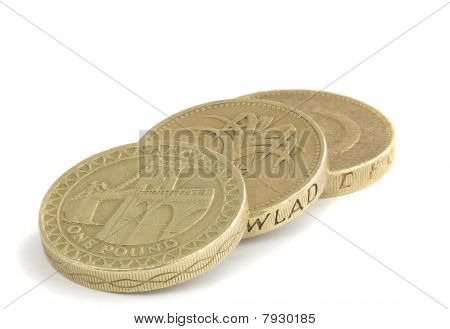 British One Pound Coins On A White Background