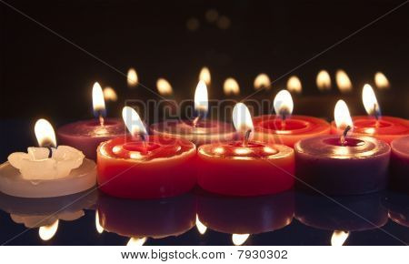 Red And White Candles On A Black Background