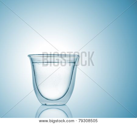 Glass With Carbonated Water On Blue Gradient Background