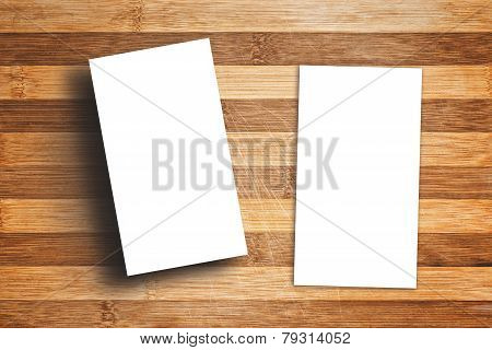 Blank Vertical Business Cards On Wooden Table