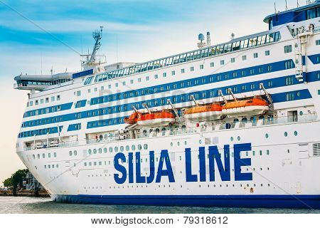 Modern ferry boat Silja Line at pier awaiting loading cargo fr