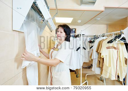 Cleaning services. Service woman worker operating with plastic bag packing machine