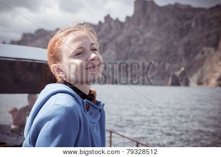Young womn enjoying boat trip