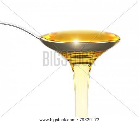 Honey flowing from a teaspoon isolated on white