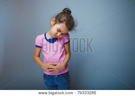 girl winced in pain holding his hands over stomach
