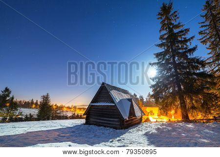 Wooden shelter in Tatra mountains at night, Poland poster