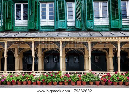poster of King palace museum with picture gallery green windows and flower pots on Durbar square in Kathmandu Nepal