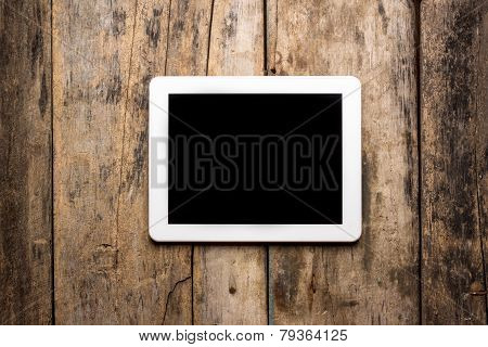 Tablet PC On Wood Background
