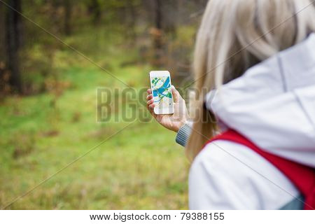 Woman using map app on smartphone